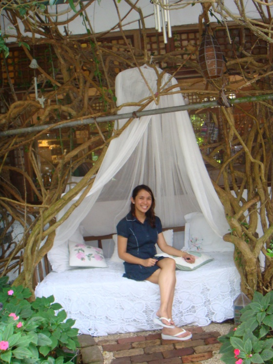 This bench covered with white linen is love... at Sonya's Garden.